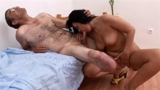 Man with amputee leg and busty milf